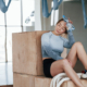 Recovering when sitting on the boxes. Sportive young woman have fitness day in the gym at morning time.